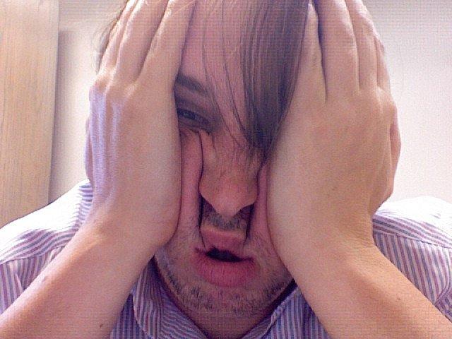 Zmęczona twarz copywritera